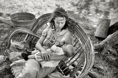 """June 1939. """"Wife and baby of itinerant cane furniture maker and agricultural day laborer camped in Wagoner County, Oklahoma."""" 35mm nitrate negative by Russell Lee for the Farm Security Administration."""