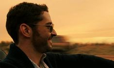 Tom Ellis is a million miles from Miranda in first trailer for US pilot Rush