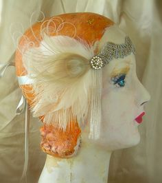 flapper headband of antique silver crochet trim and 1920's beaded fringe with cruelty free ivory and champagne feathers. $68.00, via Etsy.