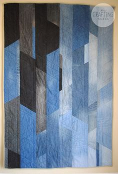 """Jean Quilt by The Crafting Shell.  """" The quilt top is made out of 7 pairs of jeans... The middle layer was a fleece blanket we were about to donate to Goodwill. Backing was fabric their grandma had."""""""