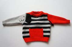 Vintage toddler sweater with elephant design.
