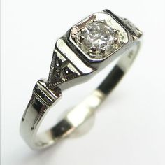 The Clean Cut: Trim and precise, this tidy ring is a crisp little statement on the hand with a super bright old European cut diamond that catches the eye.  Maloys.com