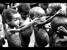 Children reaching for food, Africa.