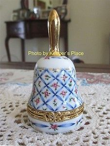 "SOLD: This is a beautiful hinged bell shaped trinket box from Lefton ~ Rare and hard to find    The pattern is Victorian floral roses and ribbons    Lots of gold accents    Date: 1997    The piece stands 3.75"" tall ~ The width (at widest point) measures 2""    The hinge and clasp work flawlessly ~ Latch is tight    The clasp is a gold ribbon that blends in with the theme of roses and ribbons    This piece is in excellent condition with no chips, cracks, crazing or repairs"