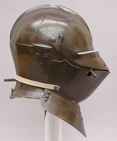 Armet with Matching Wrapper - ca. 1475; Italian, probably Milan; Steel;   The armet was typically worn with a wrapper, a reinforcing plate that gave extra protection to the lower face and neck area. This is a rare ...