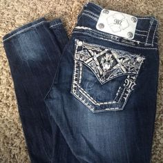 Miss Me Size 24 Ankle Skinny Like new Miss Me ankle skinny. Size 24. No signs of wear. Zipper works and never hemmed. Baby blue rhinestones on back pockets- illusion pockets they look like flaps but they're regular pickets. Gorgeous white M patch on back. 10% bundle off 2+ items!!! Miss Me Jeans Skinny