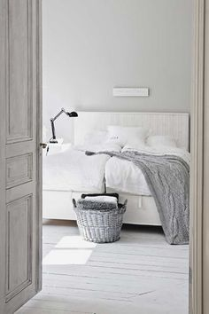 dreamy! Love the white washed refurbished BR doors...