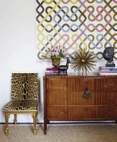 love the mod art, accessories & leopard chair (hoping it's faux leopard)