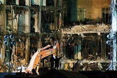 Rescue workers work late Sept. 18 in Washington, D.C., sifting through piles of debris from the section of the Pentagon hit by a hijacked plane.