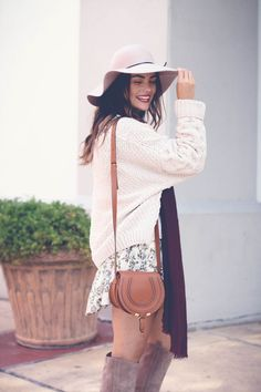 layering a cozy sweater over summer florals for a fall appropriate look! | /thestyledfox/