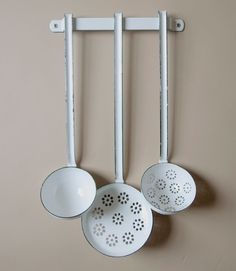 White vitreous enamel 12cm skimmer, 9cm draining ladle, and 9cm ladle available either individually or else complete with a wall bar as a set of 3.