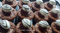 Rugby Cupcakes...I have produced these for rugby charity events and birthday parties. Available as a brownie cupcake, chcocolate truffle cupcake or chocolate and banana marbled cupcakes. The rugby ball is made from fondant icing and the 'GILBERT' design is drawn on using edible ink. The rugby ball is then balanced on a 'puddle' of chocolate ganache...x