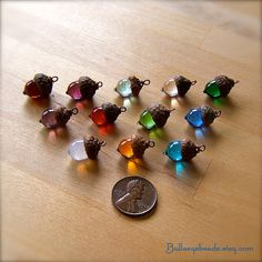 I've wanted one for a couple of years now! BIRTHDAY!!!! Glass Mini Acorn Necklace  Choose your own by bullseyebeads, $22.00