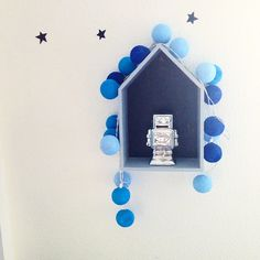 Little house with robot / Happy Lights cotton ball string lights in shades of blue / http://dottie.dk