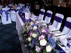 (pic 3 of The top table was dressed with a purple satin runner, and a long and low arrangement to compliment the martini vases. Blue Purple Wedding, Blue Wedding Flowers, Purple Satin, Wedding Table Decorations, Wedding Arrangements, Manchester Academy, Flower Company, Pacific Blue, Blue Roses