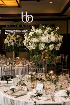 Tall white and green garden centerpieces on silver candelabras and mirrored platform.  La Tavola linens, rosemary place settings, Lodge Torrey Pines, designed by Crown Weddings, 828 images