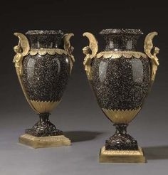 A PAIR OF EMPIRE ORMOLU-MOUNTED SARREGUEMINES SIMULATED PORPHYRY VASES  CIRCA 1805  Each with everted rim above a waisted neck and a stiff leaf and scalloped border, flanked by winged maidens, above a stiff leaf cup and a circular foot, on a square stepped and stiff leaf-cast plinth  18 in. (45.5 cm.) high (2)