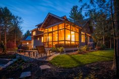Completed custom home at dusk, rear view with stone patio. Louden Ridge, Saratoga Springs, NY