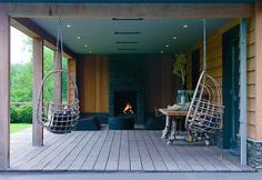 Biiig covered porch with hanging swing chairs