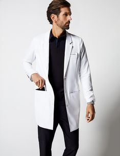 Charles Lab Coat in White is a contemporary addition to men's medical outfits. Shop Jaanuu for scrubs, lab coats and other medical apparel. Lab Coats For Men, Dr Coats, Scrub Suit Design, Mens Doctor, Doctor Coat, White Lab Coat, Medical Uniforms, Camisa Polo, Men In Uniform