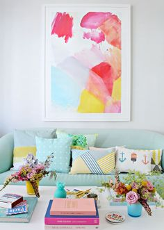Make a statement in your home by hanging oversized artwork on your walls. Geraldine, of Little Big Bell, shows you how to get that gallery wall look you've been dreaming of. She started by finding a print that matched the rest of the color palette in her living room. Then, she used fresh flowers to recreate the look throughout the room.