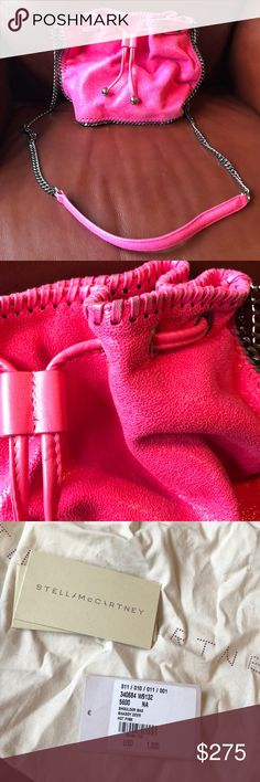 Stella McCartney Small Falabella Bucket Crossbody Hot Pink Small Bucket Drawstring Handbag with original tags and dust bag. Some discoloration along top stitching  Hot pink  faux leather, gunmetal-tone chain border and shoulder strap, whip stitch border, rectangular base Top opening with faux leather drawstring and magnetic snap closure, interior slip pocket, pink logo lining 100% organic cotton designer dust bag included Made in Italy 100% Polyester Product measures: Length 20cm / Width 9cm…