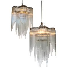 1920's French glass straw art deco chandeliers. Metal frames with punched copper decorated rim. Three rows of glass straws.