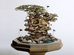 Artist cultivates magical microcosmic worlds with miniature bonsai trees