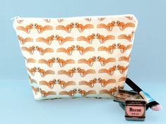 Makeup bags and wash bags available in a range of designs. The wash bags are made with water resistant fabric, perfect for using in the bathroom for toiletries. Animal Makeup, Peg Bag, Makeup Remover Pads, Fabric Animals, Red Squirrel, Cosmetic Pouch, Makeup Case, Wash Bags, Beauty Essentials