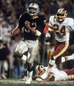 Marcus Allen running away from Redskin Anthony Washington in Super Bowl XVIII.