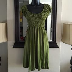 Sweet Little Green Dress Hunter green dress with elastic top detail. Knit fabric. Dresses
