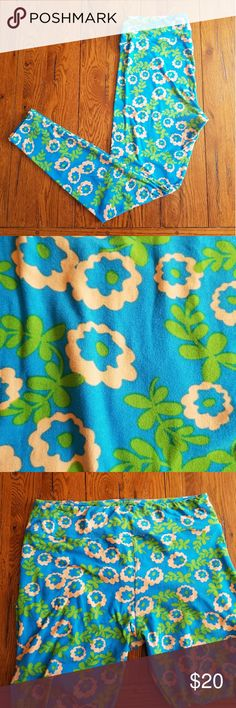 Lularoe TC leggings Blue background, green leaves. The flowers are a pinky tan color. Worn once, washed once per Lularoe instructions. No rips or stains. Slight fuzziness indicated in second picture. Loose thread in groin area indicated in 5th picture. LuLaRoe Pants Leggings