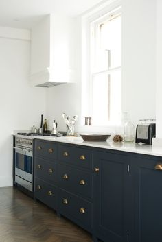 deVOL Shaker Kitchen – Pantry Blue.. I like that plain plastered extractor hood-- quiet and useful for tying in architectural elements