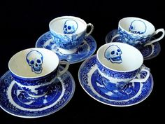Strictly One Of A Kind    Reworked vintage English mismatched Willow patterned blue and white teacups and saucers vandalized with skulls from my original drawings.  Two saucers have tiny chips and one cup has a small crack on the rim but is sound enough for use.   Each Skull is in heat fused Porcelaine ceramic paint, is hand painted and non-toxic. Beverage safe.  Hand wash with care.  Product care label is attached.    My items are tax and duty free for ALL shoppers outside of New Zealand…