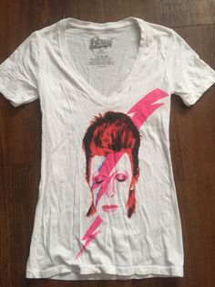 super lightweight Bowie Tee featuring the album cover of Alladin Sane. Size (S) Gently Pre Loved T-shirt no returns or exchanges on clothing that doesn't fit   #davidbowie #ripdavidbowie #hunkydory #aladdinsane #blackstar #spidersfrommars #glam #ziggystardust #klausnomi #youngamericans #heroes #spaceoddity #underpressure #starman #rebelrebel #ashestoashes #modernlove #chinagirl #labyrinth #themanwhofelltoearth
