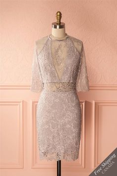 Valanthe #Boutique1861/ Bare all with this dainty, yet daring cocktail dress! The crocheted lace is lined with a stretch fabric for ultimate comfort, revealing your waist. The finer lace/ mesh blend used in the sleeves, décolletage, and back will shimmer as it lets your sun-kissed skin shine through. A button at the nape of the neck and zipper in back makes it a breeze to wear.