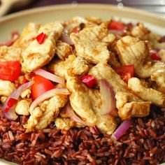 Bhutanese Chili Chicken with Red Rice chicken red rice cornstarch sesame oil red onion garlic red hot chili pepper ginger soy sauce tomato