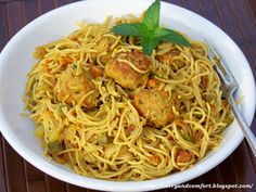 Indian Masala Spaghetti and Meatballs Recipe Main Dishes with ground meat, garlic, fresh ginger, mint candies, curry leaves, onions, ground cumin, garam masala, bread, crushed red pepper flakes, salt, pepper, onions, carrots, celery, fresh tomatoes, garlic, ginger, curry leaves, green chile, black mustard seeds, cumin seed, curry powder, garam masala, crushed red pepper flakes, turmeric, chicken broth, salt, pepper