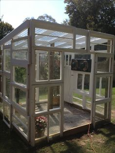 New greenhouse from old windows. I LOVE, LOVE, LOVE THIS!!!!! :)