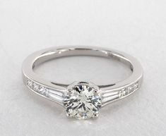 Tapered Baguette and Princess Engagement Ring   14K White Gold   17186W14   A tailored, graduated channel set engagement ring features tapered baguette and princess diamonds. Hand crafted to perfectly compliment the center diamond or gemstone of your choice.