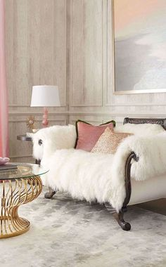 """#ONLYATNM Only Here. Only Ours. Exclusively for You. Handcrafted settee. Hardwood frame with carved detailing. Sheepskin and fabric upholstery. 68""""W x 36""""D x 36.5""""T. Seat, 42""""W x 25.5""""D x 17""""T; arms,"""