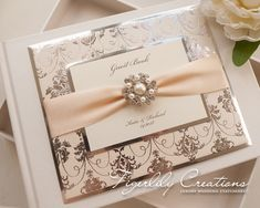 """""""Regal Mirror"""" Guest Book featuring silver mirror card, foiled paper layer, satin ribbon and beautiful pearl and crystal cluster brooch. #weddingguestbook #guestbook #regal #royalwedding #regalwedding #foilweddingstationery #foilguestbook #foilweddingguestbook #glamorousguestbook"""