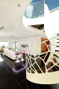 Fancy The staircase look stunning against our very linear Alno kitchen with Corian tops and Miele appliances