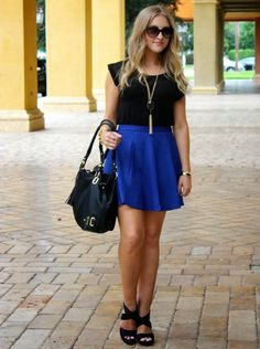 I love the color of this skirt, and the silhouette you get when you tuck a black tee into it. I'd pair with flat black sandals instead and maybe a different bag, but I'm into the rest!