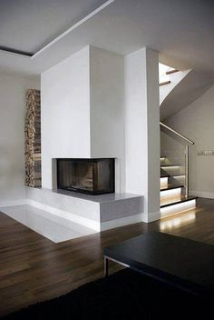 Don't have the full for a full-scale fireplace? Discover the top 70 best corner fireplace designs featuring luxury angled interior ideas and inspiration. Build A Fireplace, Fireplace Bookshelves, Home Fireplace, Modern Fireplace, Living Room With Fireplace, Concrete Fireplace, Fireplace Ideas, Corner Fireplace Decorating, Contemporary Fireplace Designs