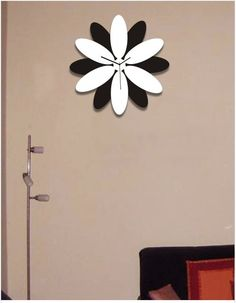 A really fab flower clock design at www.gloob.in, India's First online boutique in home decor. The Clock frame made out of acrylic can be hung on to the wall while the solid hands on it give a sleek look to elevate your home interiors. Shop,gift now.