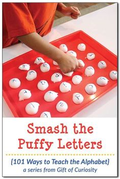Smash the Puffy Letters is a letter learning activity that gives kids a chance to smash, squeeze, and pound their way to learning the alphabet.  Great for kinesthetic learners and active kids! || Gift of Curiosity