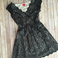 """Cap sleeve lace overlay dress Beautiful black dress with cap sleeves and elegant scalloping detail at hem and neckline. Black lace & tan/cream colored lining. Super cute look for a wedding or a night out. Comes with a belt not pictured. In excellent condition. Size 2. Measures about 17"""" underarm to underarm, waist is approx 12"""" and length is 33"""" - open to reasonable offers, no trades. Thx for shopping my closet  Elle Dresses Midi"""