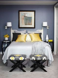 Pleasing Palette..Slate blue-gray and golden yellow mingles with soft whites and grays to look right on trend. Although many people shy away from going dark in a small space, this bedroom proves it can look just right. The white ceiling, trim, and bed frame help mellow the potentially overwhelming look of the rich navy walls. #decorate #bedroom