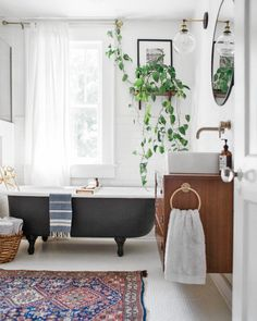 Tulsa Owen Park Sears Kit Home renovated bathroom. Vintage modern decor and house renovated bathroom. Vintage modern decor and house plants. Bohemian Bathroom, Eclectic Bathroom, Bathroom Interior, Bathroom Vintage, 1920s Bathroom, Vintage Tub, Bathroom Modern, Minimalist Bathroom, Vintage Home Décor